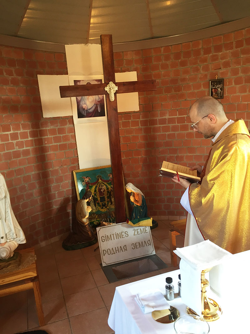 Father Michael Mrzyglod saying prayers over Kazickas remains in Saint Katherine's chapel. July, 2016